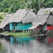 17708322-An-indigenous-house-in-the-Amazon-river-basin-near-Iquitos-Peru-Stock-Photo